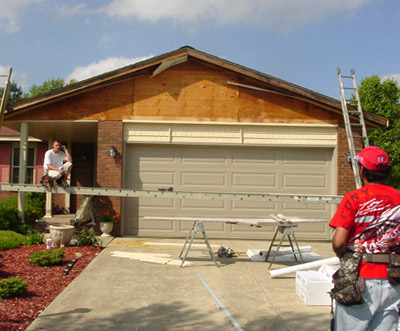 Clear Choice Home Improvements Crew Replacing Siding Over Garage Door